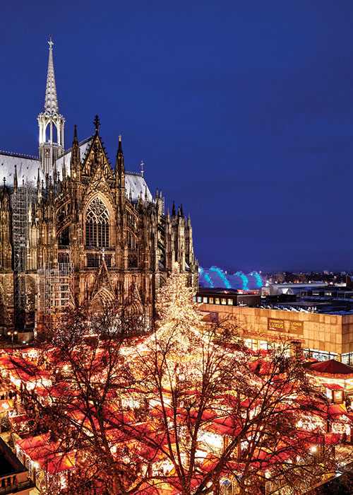 The Cathedral Market's illuminated scene in Cologne.