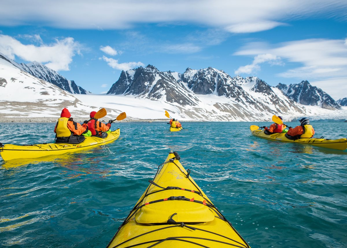 Kayaking theMagdalenefjorden coastline in Norway with Silversea Expeditions.