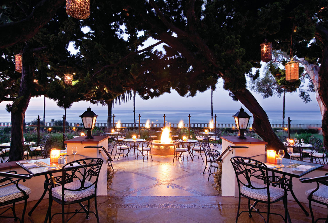 Evening settles on the Bella Vista dining patio at the Four Seasons Resort the Biltmore Santa Barbara.