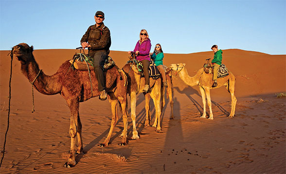 Family of 4 riding camels