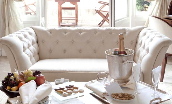 couch and table with champagne and fruit